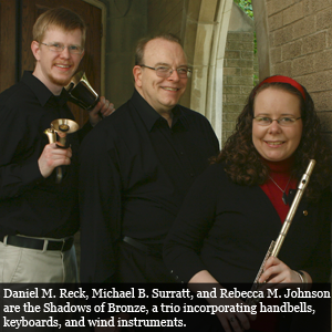 Daniel M.  Reck, Michael B. Surratt, and Rebecca M. Johnson are the Shadows of  Bronze, a trio incorporating handbells, keyboards, and wind  instruments.